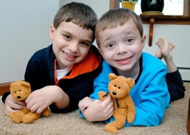 """Pictured is Willliam Relyea, diagnosed with neuroblastoma at the age of 9 months, with his brother and their """"You and Me"""" bears."""