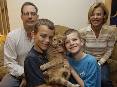Leo Lytel, second from right, and his family David Lytel, left, Lucas Lytel, and Jayne Lytel pose for a photograph in their home in Washington Wednesday, May 6, 2009.