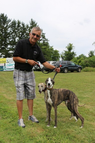 Dick Bordonaro of Syracuse poses with his dogs Pilot and Axl.
