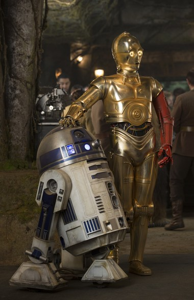"""This photo provided by Disney shows, R2-D2, left, and Anthony Daniels as C-3PO, in a scene from the new film, """"Star Wars: The Force Awakens,"""" directed by J.J. Abrams."""