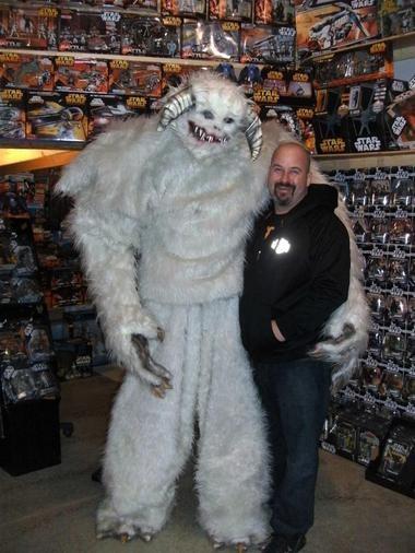 Brett Rewakowski wears his Hoth wampa ice creature costume next to a 6-foot-tall man.