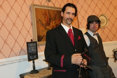 Andrew DeRuiter (the front desk greeter) and Blake Condolora (the bartender) at the Hotel Whitmore escape room.