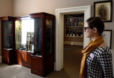 Director of development Natalie Stetson stands in the Civil War exhibits of The Seward House Museum in 2015.