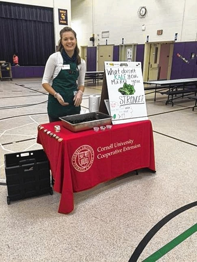 Margaret Liljedahl from Cornell Cooperative Extension in Newark, NY, helps out with kale chip sampling at Clyde-Savannah Elementary School. Donna Riviello was named the state's Food Service Director the year for inventive ideas like this.