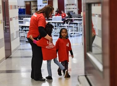 A student gets a hug from principal Carin Reeve-Larham at Dr. Weeks Elementary School at 710 Hawley Ave.