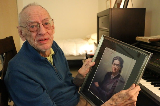 Phil Klein holds up a picture of his former music teacher, Helen M. Hosmer. Photo: Katrina Tulloch