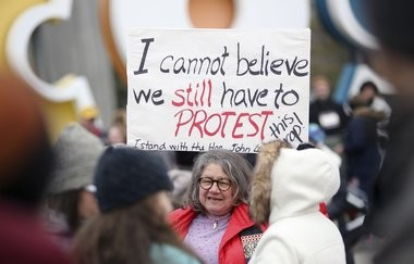 Diana Angus, of Columbus, Ohio, holds a sign she made at home before the start of the Women's March on Washington - Ohio Sister March in Columbus, Ohio on Sunday, Jan. 15, 2017.