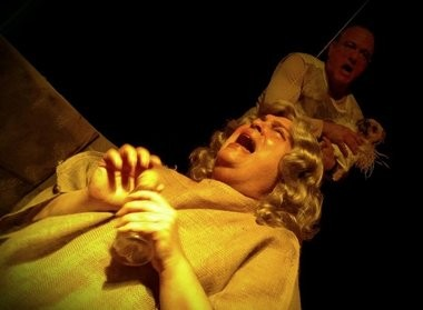 Geno Parlato, left, and David Minikhiem in a scene from Rarely Done's production of Silence of the Lambs by Jamie Morris.