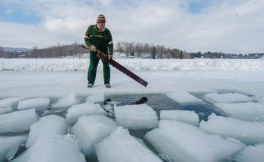 John Bieber prepares to saw through the ice during the Tully Area Historical Society Ice Harvest Festival in Tully, New York on Sunday, February 22, 2015.