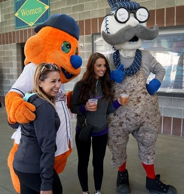 Syracuse Chiefs mascots Scooch and Pops pose for pictures with fans.