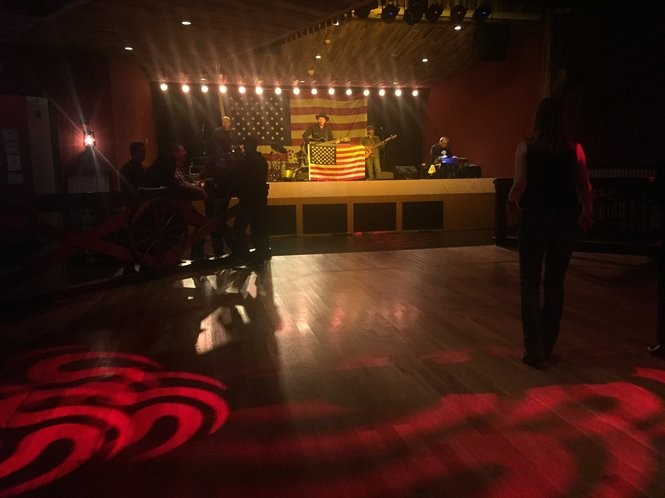 The dance floor at BG Cowboys Saloon, with a flag-on-flag set from Matt Chase. (Tory Russo)