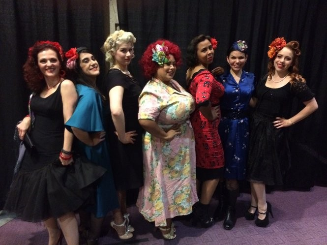 """The Salt City Belles show off their themed attire for a group attendance at Syracuse Opera's """"Carmen"""" Friday at Crouse-Hinds Theater. Some were attending their first performance of Bizet's familiar opera, and others were there for their third, fourth or sixth viewing. From left are Gina Santucci, Stefania Ianno, Erin Kennedy, Nicole Jones, Jamie Owens, Francesca Howard, and Samantha Zimnock. The opera plays again Sunday at 2 p.m."""