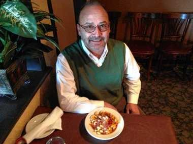"Peter Nestico with the ""Americanized"" version of goulash at Nestico's Restaurant in North Syracuse. It's a tomato sauce-and-ground beef dish served over pasta."