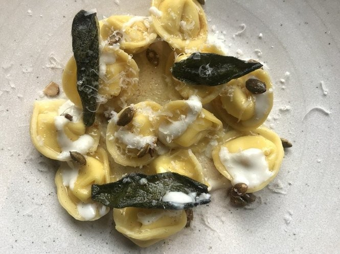 Butternut squash cappelletti with taleggio fonduta, spiced pepitas, brown butter and sage at a mano kitchen & bar.