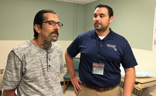 Frank Panico, left, was one of the first patients treated in an addiction clinic started by Dr. Ross Sullivan, right, in Upstate's emergency room.