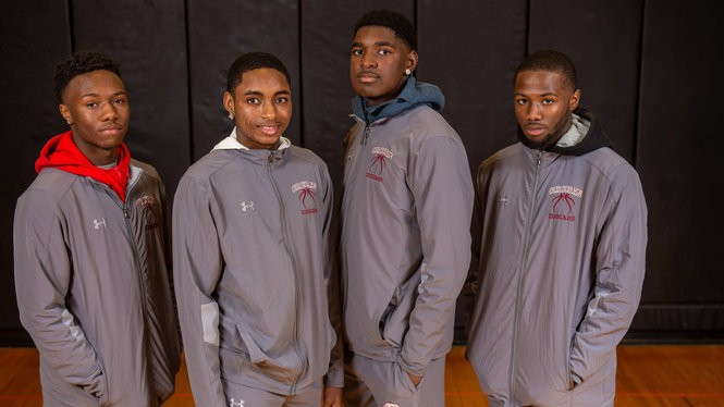 Corcoran players (from left) De'jour Reaves, Daimarr Miller, Dewayne Young and Branden Denham at Section III basketball media day. (N. Scott Trimble | strimble@syracuse.com)