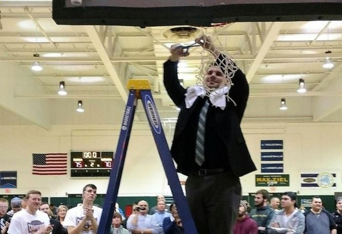Luke Tucci cuts part of the net down as an assistant after Oswego State won the SUNYAC men's basketball championship in 2017. Tucci takes over at Fayetteville-Manlius this season. Provided photo Provided photo
