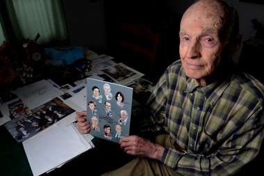 Ed Lukens with scrapbooks and memories at his Skaneateles home: Decades after his retirement as an educator, many students he coached or taught still remain in touch.
