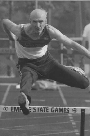 Ed Lukens, running the hurdles in 1987 as a 65-year-old masters competitor.