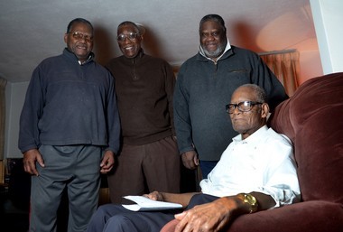 Linton Betsey, 92, seated, with his sons Robert (left) and John (right), and Manny Breland, center. Shown at Linton's home, they're all part of a panel that will discuss the African-American experience in Syracuse on Sunday at the Barnes Hiscock mansion. Missing are panelists Marshall Nelson and Theardis Martino.