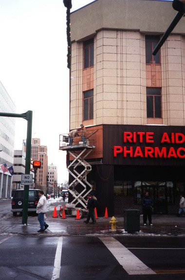 In 1997, a big wind ripped the metal sign off the Rite Aid building and temporarily revealed the old exterior clock from F.W. Woolworth, frozen at 1:06 p.m. Rite Aid quickly put the sign back up, again hiding the clock.