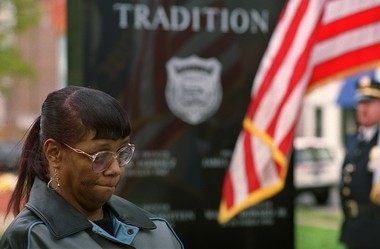 Delores Howard, at a service for her son Wallie, police memorial, Forman Park.