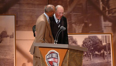 Dave Bing, former Syracuse University star, greets longtime SU coach Jim Boeheim after Boeheim's induction into the Naismith Memorial Basketball Hall of Fame in Springfield, Mass.