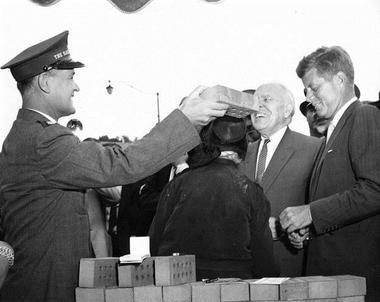 Pictured here: President Kennedy on the far right, Major John Wilson on the far left.