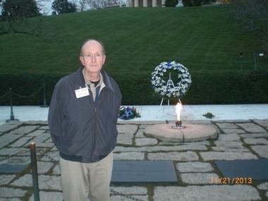 John Young, at the grave of President John F. Kennedy, Arlington.