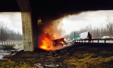 The pickup truck of Capt. Timothy Neild of the National Guard, moments after Neild was rescued from the burning vehicle along the state Thruway, in DeWitt.