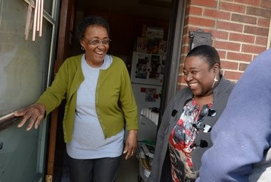 Tina Shareef at the door of Jean Singletary, the longtime Pioneer Homes neighbor she calls 'Miss Jean.' Singletary has lived in the same unit since 1960.