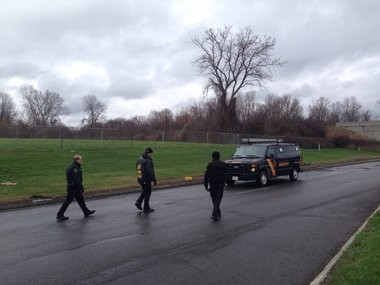 Deputies with the Onondaga County Sheriff's Office on Electronics Parkway in Salina, where Michael Mahoney was struck and killed while riding his bicycle.
