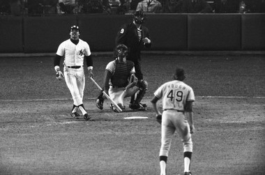 Note the 'pro ring' on the Adirondack bat: New York's Reggie Jackson watches the path of his third home run in the eighth inning, off Dodgers' Charlie Hough during game 6 of 1977 World Series against Los Angeles Dodgers: Yankee Stadium in New York on Oct. 18, 1977. New York won the game 8-4, for its 21st World Series championship.