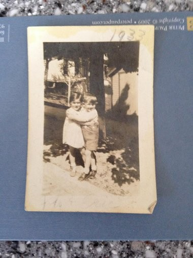 The photo that triggered Eric Carle's search for a long-lost friend. Eric in 1932 on John Sreet in Syracuse, with a little girl who turned out to be Florence Ciani Trovato.