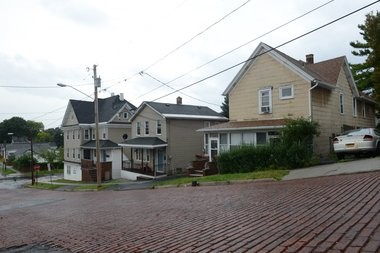 John Street in Syracuse, today: Eric Carle's family lived, around 1930, in the third house from the corner of John and Carbon streets. Florence Ciani Trovato would visit her grandparents there; she also lived for a time in the house at the corner.