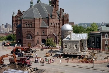 The Holden Observatory is relocated in 1991, west of its original location, to make way for the construction of Eggers Hall on the main campus: June 26, 1991.