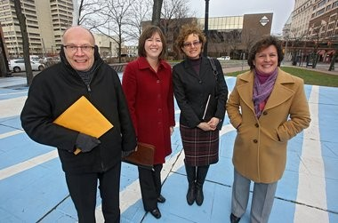 """Downtown developer and planner George Curry, Merike Treier of the Downtown Committee, Syracuse public art coordinator Kate Auwaerter and Mayor Stephanie Miner at Perserverance Park: Hoping for a """"world-class"""" attraction."""