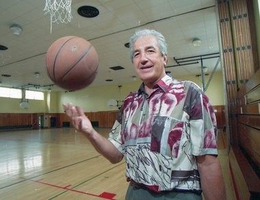 Dolph Schayes, a Hall of Famer from the championship Syracuse Nationals of 1955, at the Blodgett school, where the 24-second clock was used for the first time, in a scrimmage.