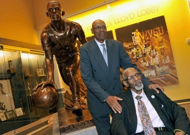 Jim Tucker and Earl Lloyd (seated), at last year's dedication of a statue of Lloyd, a Hall of Famer, at West Virginia State, his alma mater. Lloyd died last month, in Tennesee; Tucker will attend a reunion of the Nats in Syracuse, in April.