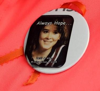 The button Lisa Buske wears, in honor of her sister, Heidi Allen.