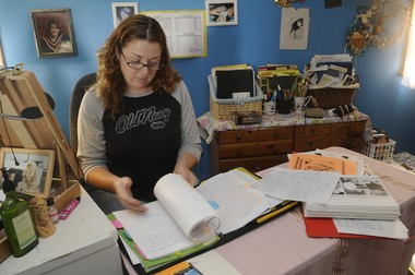 """Lisa Buske at her home in Oswego County in 2010, working on a book - """"Where's Heidi? One Sister's Journey"""" - about her journey after the disappearance of her sister, Heidi Allen."""