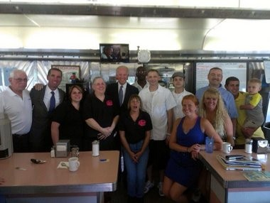 Beau Biden and his father, Vice President Joseph Biden, at Hunter's Diner in Auburn - an establishment once owned by Beau's grandparents. Image includes, (left to right) Ed Eggleston, Beau Biden, Kara Kozanitis, Anna Rogers, Vice President Biden, Lisa Kozanitis, Rob Rogers, Todd Lusk, Neil Woodward, Ashley Hadden, Bill Juhl, Rachael Juhl, Bill Juhl Jr. and Brayden Juhl.