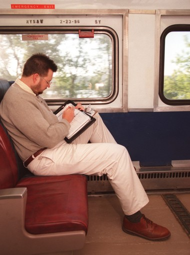 Adam Ormsby, who works at the VA Hospital, catches up on some reading while on a free Ontrack train from Jamesville into downtown Syracuse.