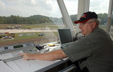 Racing historian Gary Spaid watches a race at Rolling Wheels: Saddened by the loss of racing at the Moody Mile.