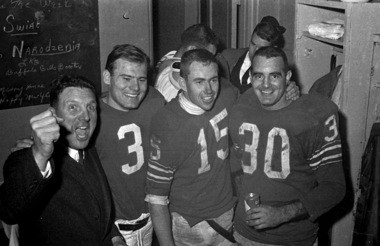 In this Dec. 26, 1964, photo Buffalo Bills' coach Lou Saban, left, lets out a cheer with Pete Gogolak (3), Jack Kemp (15), and Wray Carlton (30) in the Bills' dressing room in Buffalo after winning the American Football League Championship. Gogolak believes that Bills team could have competed with the best in the National Football League.