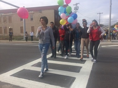 A group of neighborhood teens, students make their way across the new West Street crosswalk.
