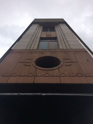 The terra cotta exterior of the old F.W. Woolworth building in downtown Syracuse, and a spot where a clock used to be - and will be again, following a restoration.