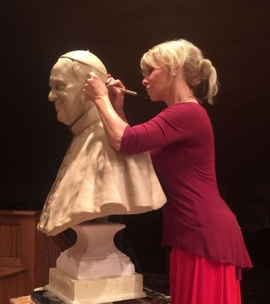Carolyn Palmer, who had a Syracuse studio for many years, working on a sculpture of Pope Francis.