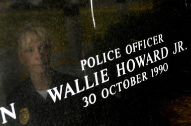 In 2010, Syracuse Police Deputy Chief Rebecca Thompson visited at the Wallie Howard Jr. memorial in Forman Park. Thompson was part of Howard's detail on the day he was shot to death, in 1990. Photo By Frank Ordonez / The Post-Standard