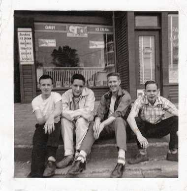 """Four friends who grew up immersed in the Irish traditions and culture that found a home in Tipperary Hill, Syracuse, are seen here in a 1957 photo snapped at the corner of Milton Avenue and Tompkins Street, They are, left to right, John """"Bocko"""" Young, John """"Shadow"""" Shannon, John """"Mac"""" McCarthy, Robert """"Bobby O O"""" O'Neil."""